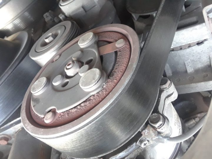 Compressor clutch assembly damaged due to pressure plate slippage